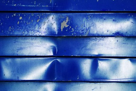 oxidation: Corrugated metal sheet blue color. Texture of metal fence.