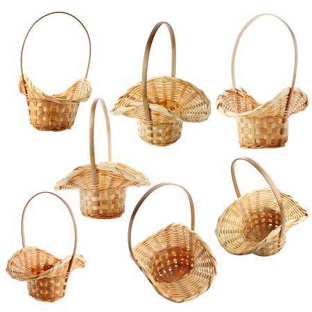 Set of empty wicker baskets isolated on white photo