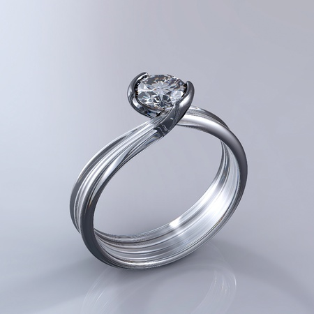 Ring with diamond isolated on grey background Stock Photo