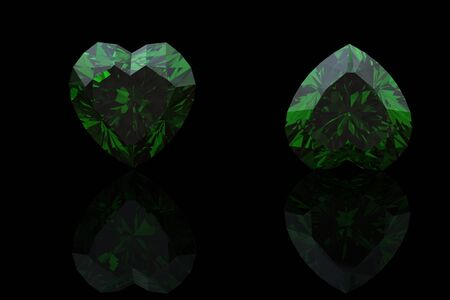 Emerald shape of heart  on black background photo