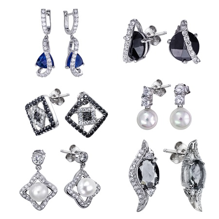 Stylish jewelry. Earrings  with gems isolated on white background