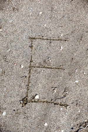 Collection of  handwritten English alphabet in the sand exotic beach sea  education,letter,text,vacation or tourism photo