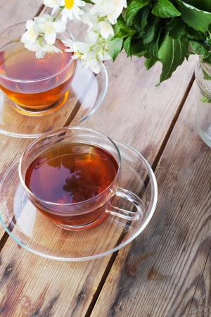 Transparent cup with green tea and fresh herbs Stok Fotoğraf