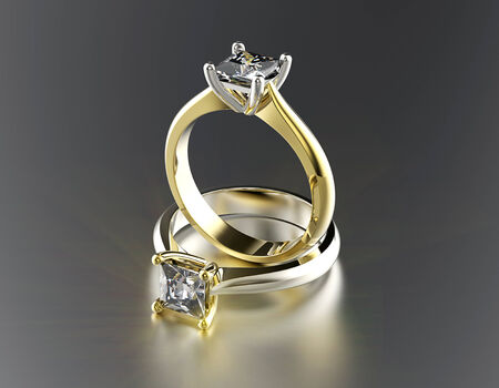 Golden Engagement Ring with Diamond or moissanite  Jewelry background