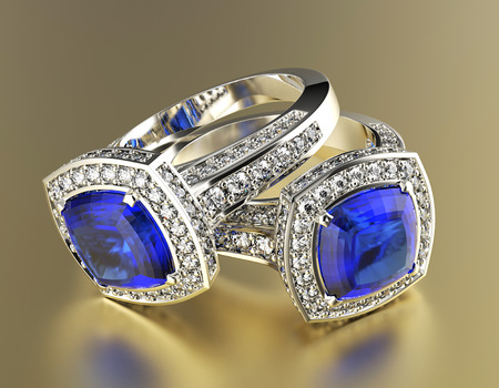 Golden Engagement Ring with Diamond. Jewelry background. Sapphire