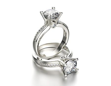 Engagement Ring with Diamond on white. Jewelry background Stok Fotoğraf