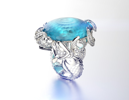 topaz: Golden Engagement Ring with Blue topaz. Fashion Jewelry background