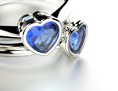 Golden Engagement Ring with heart shape sapphire. Jewelry background