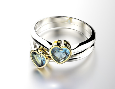 Ring with  Blue topaz or aquamarin heart shape.  Stock Photo