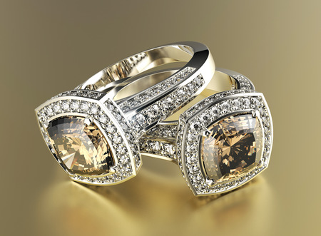 Golden Engagement Ring with Cognac Diamond. Jewelry background