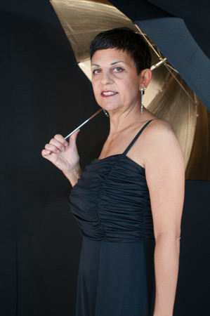 Portrait of beautiful middle aged woman with cute umbrella
