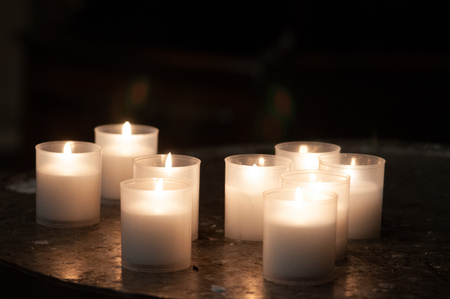 Lighting Prayer Candles in a Church Prayer Memorial candles in a church Stock Photo