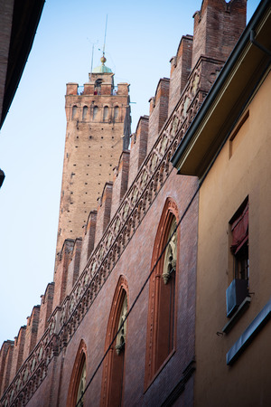 Palazzo Pepoli, home of the Museum of History of Bologna, Italy. In the background is the Torre degli Asinelli, a commonly recognized symbol of Bologna.