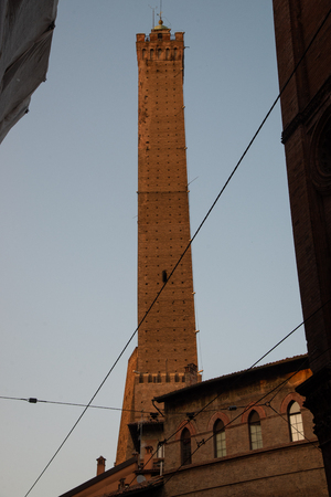 The Torre degli Asinelli, a commonly recognized symbol of Bologna, Italy. Made of masonry, they carried out important military functions (signaling and defense). 写真素材