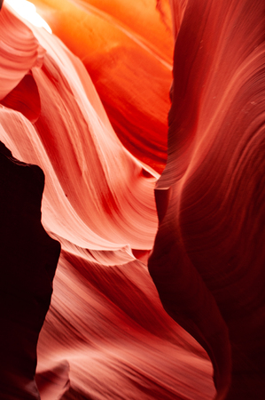 Brilliant colors of Upper Antelope Canyon, the famous slot canyon in the Navajo reservation near Page, Arizona, USA. Beautiful view of amazing sandstone formations in the famous antelope canyon.