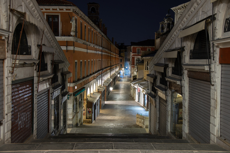 Night photo of the Ruga dei Oresi road from Rialto Bridge in Venice, Italy. In the district of San Polo is the road that goes from the bridge to the market area.
