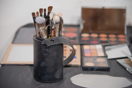 Make-up artist theme. Various makeup products. View from above. Professional cosmetics set: make-up brushes, shadows, lipstick. Beauty, fashion and retail, conceptual still life.