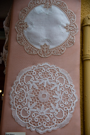 Centerpiece in lace and embroidery fabrics. Souvenir shops in Burano. Venice. Italy. The famous Burano lace is made by local artisans.