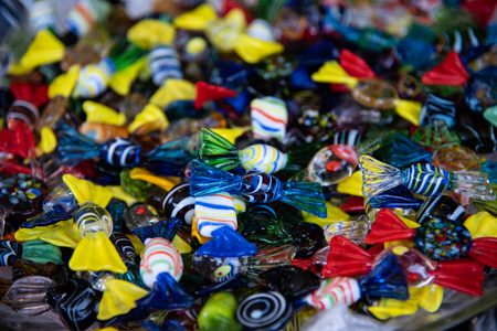 Colored candies in Murano artistic glass. Artistic realization typical of the Venetian island. Italy - Venice - Murano - production of the famous Murano glass.