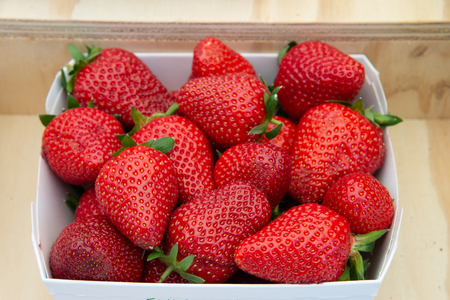 Basket of juicy red strawberries. Fruits with high nutritional value, ready to be sold on the market or to be eaten directly.