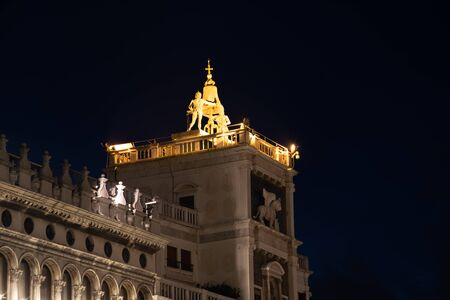 Night photograph of the clock tower, Venice, Italy. Detail of the Renaissance building located in Piazza San Marco.