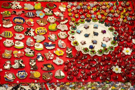 Small objects with a Christmas theme, pins, knick-knacks, turtles, colored ladybugs. Holiday decorations. Stock fotó