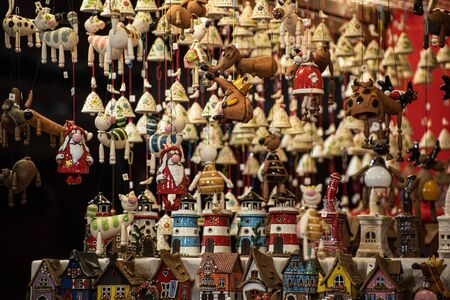 Christmas decorations, Christmas holidays. Objects with a Christmas theme, hanging pendants and colorful houses. Stock fotó