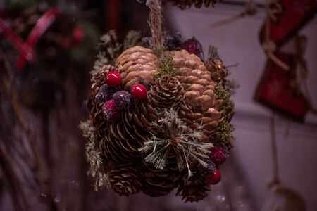 Christmas decorations and for end of year celebrations. Sprig with pine cones and red berries.