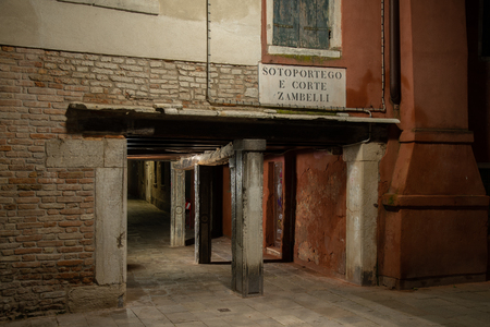 Night photography of the sotoportego Zambelli in Venice, Italy. In the foreground the columns of the building that open the house to go to the Zambelli house. Sajtókép