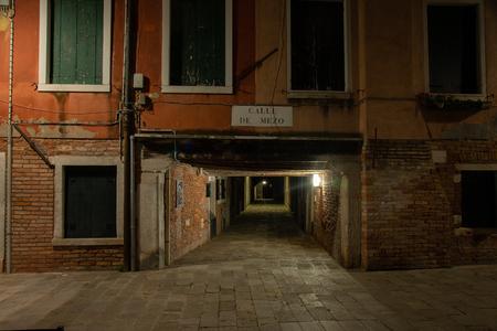 Night photography of the sotoportego calle de mezo in Venice, Italy. Typical pedestrian road passage connecting calli Venetian