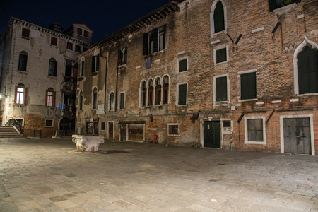 Night photography of the Campo Santa Maria Mater Domini in Venice, Italy. Small field in the Santa Croce district with the classic types of Venetian Renaissance buildings. Typical square with a bridge over the canal.