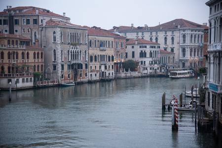 Grand Canal from the Bridge Academy in Venice, Italy. Dawn light spread over the lake with a view of the old houses and the ferry. Widespread dawn light on the Venetian lagoon. Sajtókép