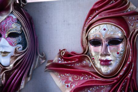 Large carnival mask depicting a woman.