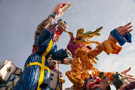 Country of Cento, Italy colorful floats parade through the streets. Monsters and gambling theme, during the Carnival event of one of the oldest in Italy and twinned with the Rio de Janeiro carnival.