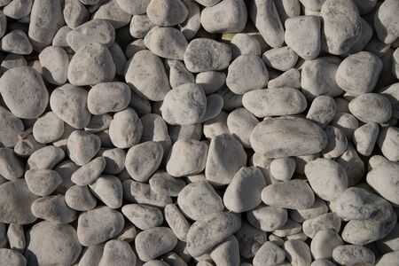 Garden pebbles, natural pebbles for garden decoration, flooring and coverings. Stones and white pebbles to decorate the garden.