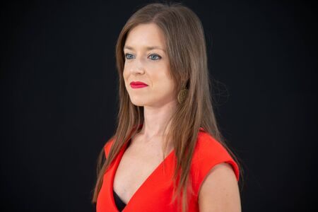 Closeup of beautiful girl with red eyes, red make-up lips, with red dress. Detail of the girl on a black background. Copy space. Stock fotó - 133372307