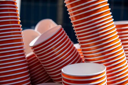 A stack of red paper cups for drinking beverages like water, wine, beer. Concept of ecological environment concept to zero eco waste. Stock fotó