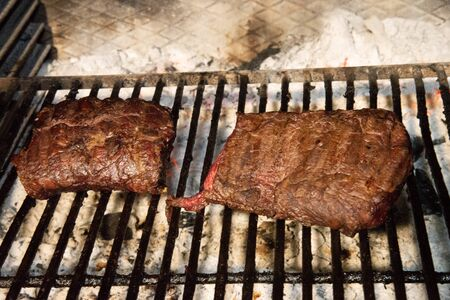 Grilled steak Two large pieces of cooked meat.