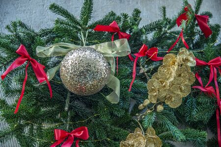 Christmas decoration with balls and pine branch.