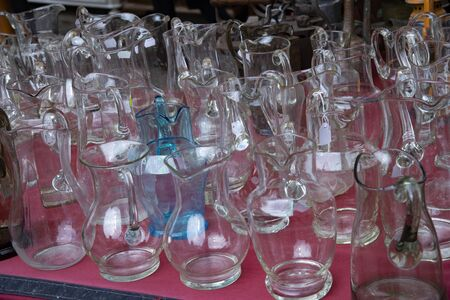 Group of vintage clear glass jugs.
