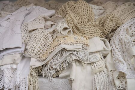 Stock cotton and lace fabrics. Sale at the market in Piazza Signori, Vicenza, Italy. Stock fotó