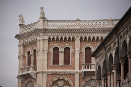 Detail of an art nouveau building in Padua, Italy. Detail of the windows with decorations and with terrace with marble lions. Stock fotó