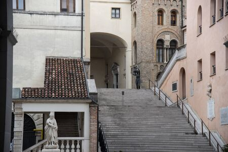Entrance staircase with bronze statue of Palazzo Moroni seat of the Town Hall of Padua, Italy. Majestic medieval building with the Palazzo della Ragione. Stock fotó