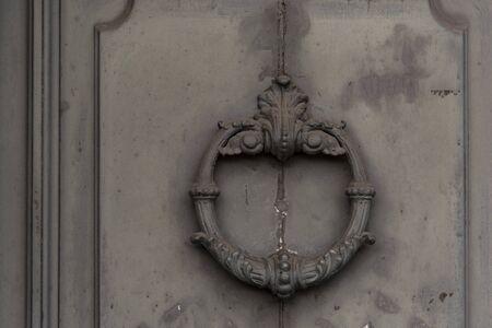 Vintage swing door handle for home in Padua, Italy.