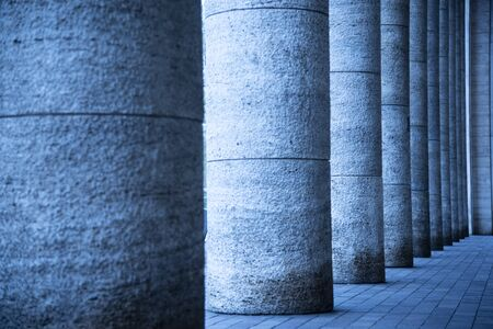 Imposing bases of ancient columns of the train station in Padua, Italy. Deliberately wrong white balance. Stock fotó