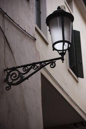 Vintage street lamp hanging on a house Padua, Italy. Stock fotó