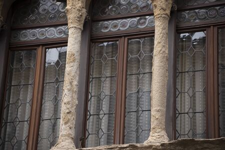 Old mullioned windows in Venetian style tuff in Padua, Italy.