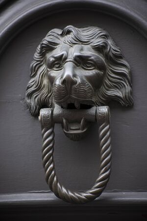 Vintage swing door handle depicting a lion for palace in Padua, Italy.