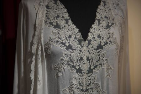 Sexy white nightdress with lace inserts on the chest. With shrug white silk dressing gown.