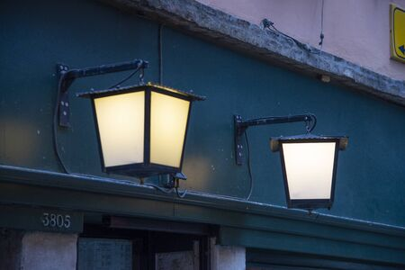 Lanterns outside an illuminated house in Venice, Italy. Night scene. Standard-Bild - 140209436